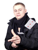 Young man in a black jacket with the cards in their hands — Stock Photo