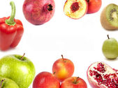 Composition of apples, kiwi, pears, pomegranate and peach pepper — Stock Photo
