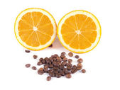 Composition of coffee beans and orange — Stock Photo