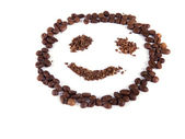 Composition of coffee beans in the form of a smiley — Stock Photo