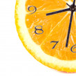 Orange fruit composition in form of hours — Stock Photo #26781281