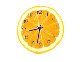Orange fruit composition in the form of hours — Stock Photo