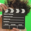 Clown with smal cinema clapboard - Stock Photo