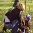 The young woman walks with the baby in park.Anamorphic wide-screen — Stock Video #12537050