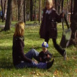 The young woman walks with the baby in park.Anamorphic wide-screen — Stock Video #12537078