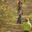 Sequence of slow motion shots happy mum and the little girl walks in autumn alley — Stock Video #12537230