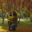 Stock Video: Slow motion shot of happy mum and little girl in autumn park