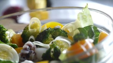 Closeup - sprinkling toppings on salad — Stock Video
