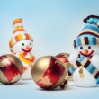 Royalty-Free Stock Photo: Snowmen with Christmas balls on blue background