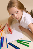 Little girl with blond hair draws — Stock Photo