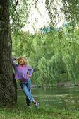 The little girl walks in nature summer — Stock Photo