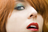 Beautiful young woman with red hair — Stock Photo