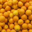 Stock Photo: Bunch of fresh mandarin oranges on market