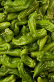 Background of green peppers — Stock Photo