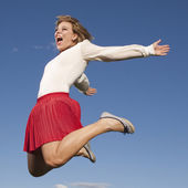 Lucky jumping woman — Stock Photo