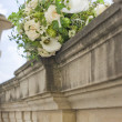 Bouquet of white roses lying on an old fence — Stock Photo