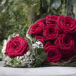 Stock Photo: Bouquet of red roses on iron plate