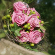 Stock Photo: Bouquet of pink roses on iron plate