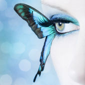 Face of a beautiful girl with a butterfly eyelashes — Stock Photo