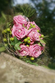 Bouquet of pink roses on an iron plate — Stock Photo