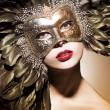 Stock Photo: Beautiful womwith VenetiMask