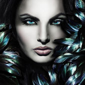 Portrait of beautiful lady with feathers — Stock Photo