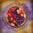 Berries and fruits on a vintage background — Stock Photo