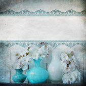 Vintage shabby chic background with flowers — Stock Photo