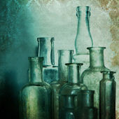 Vintage shabby chic background with old bottles — Stock Photo