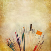 Vintage shabby chic background with paint brushes — Stock Photo