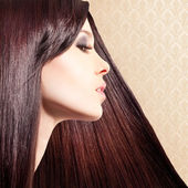 Beautiful woman with long tended hair — Stock Photo