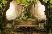 Romantic seat in a deep forest — Stock Photo
