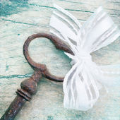Shabby Chic Background with antique key — Stock Photo