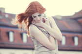 Beautiful woman with red hair — Stock Photo