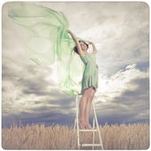 Beautiful woman in green dress background — Stok fotoğraf