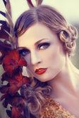 Beautiful woman in a flower field — Stock Photo