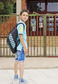 Child in front of the school — Stock Photo