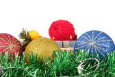 Christmas balls, candles and tinsel — Stock Photo