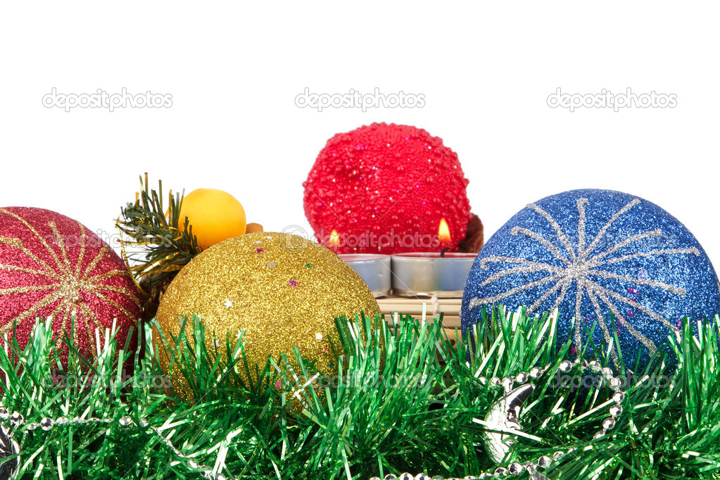 Christmas balls, candles and tinsel — Stock Photo #14695401