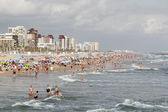 Panoramic of a crowded beach — Stock Photo