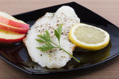 Pangasius fillet with apple and lemon — Stock Photo