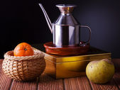 Still life with fruit and a jug of oil — Stock Photo