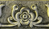 Detail of a frieze carved in stone — Stock Photo