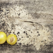 Foto de Stock  : Yellow plums on wood