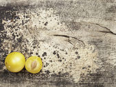 Yellow plums on wood — Stock Photo