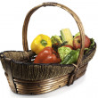 Fruits and vegetables in a wicker basket — Stock Photo #29781299
