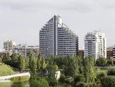 Modern building next to a public park — Stock Photo
