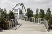 Modern bridge next to a public park — Stock Photo