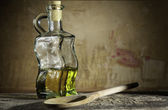 Bottle of oil on wood — Stock Photo