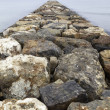 Stock Photo: Dike rocks in sea